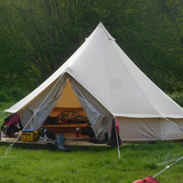 Open bell tent showing the beds inside