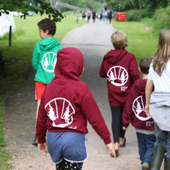 Children wearing Woodcraft hoodies