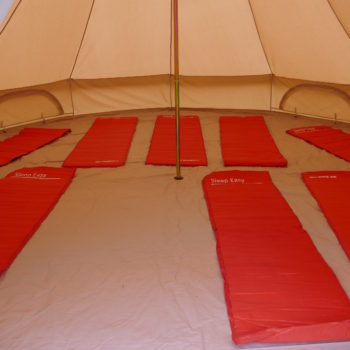 Inside of a camp Kudoo bell tens, showing the sleeping mats laid out