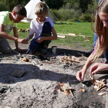 Group of children firelighting