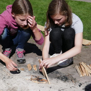 Pair of children building a fire