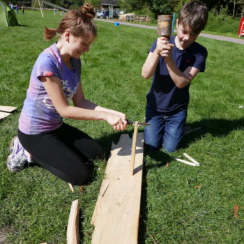 2 children splitting wood