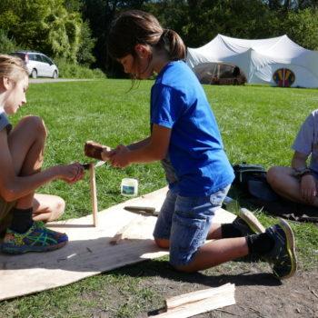 2 children splitting wood