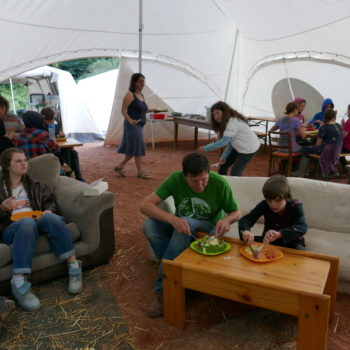 Group of people eating in the marquee