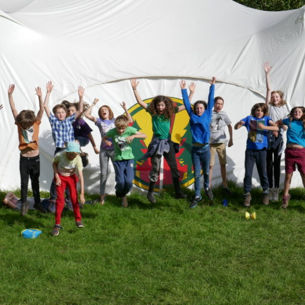 Children jumping outside the marquee