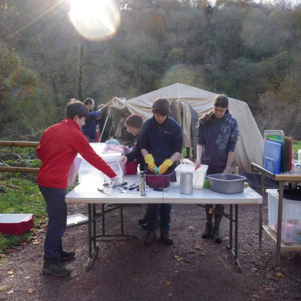 Young people washing up the Koodoo kitchen equipment
