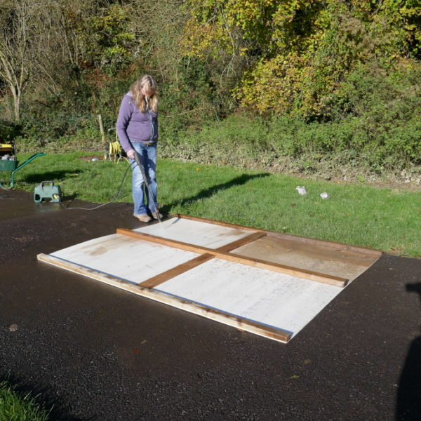 Pressure washing the fire protection boards.